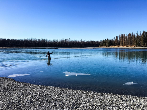 Ice floating near fisherman in Kenai River, March 2016.